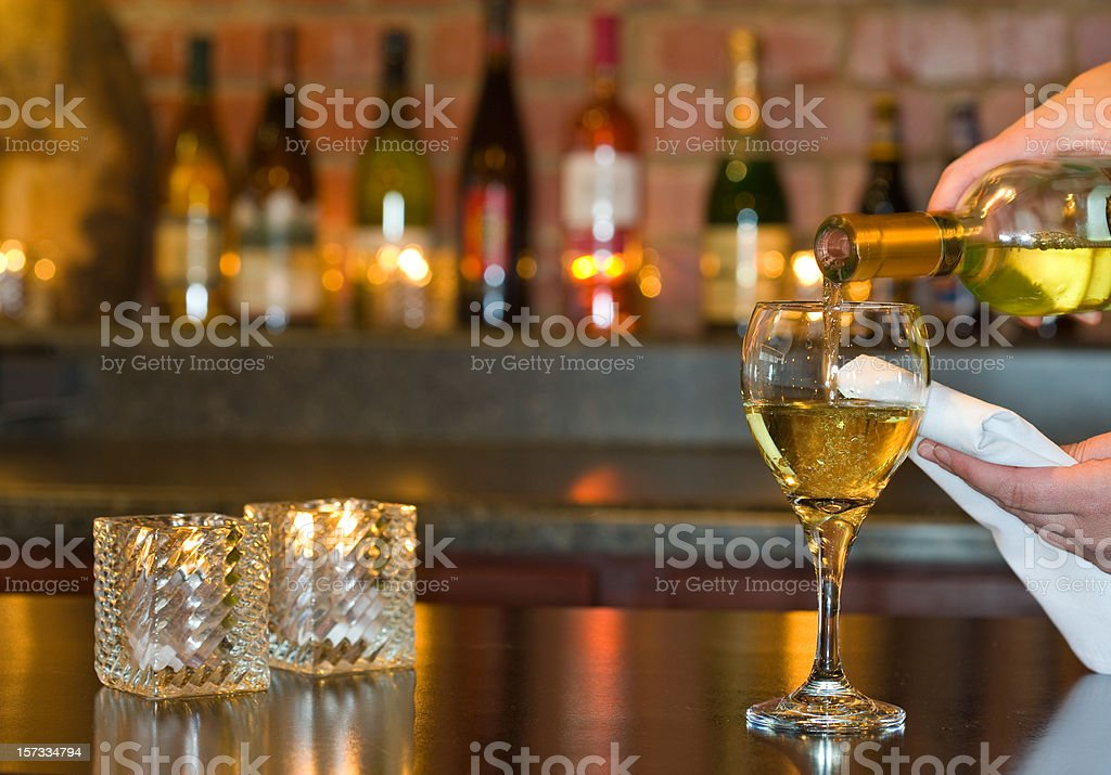 Pouring wine at an elegant restaurant royalty-free stock photo