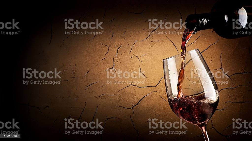 Pouring wine in cellar stock photo