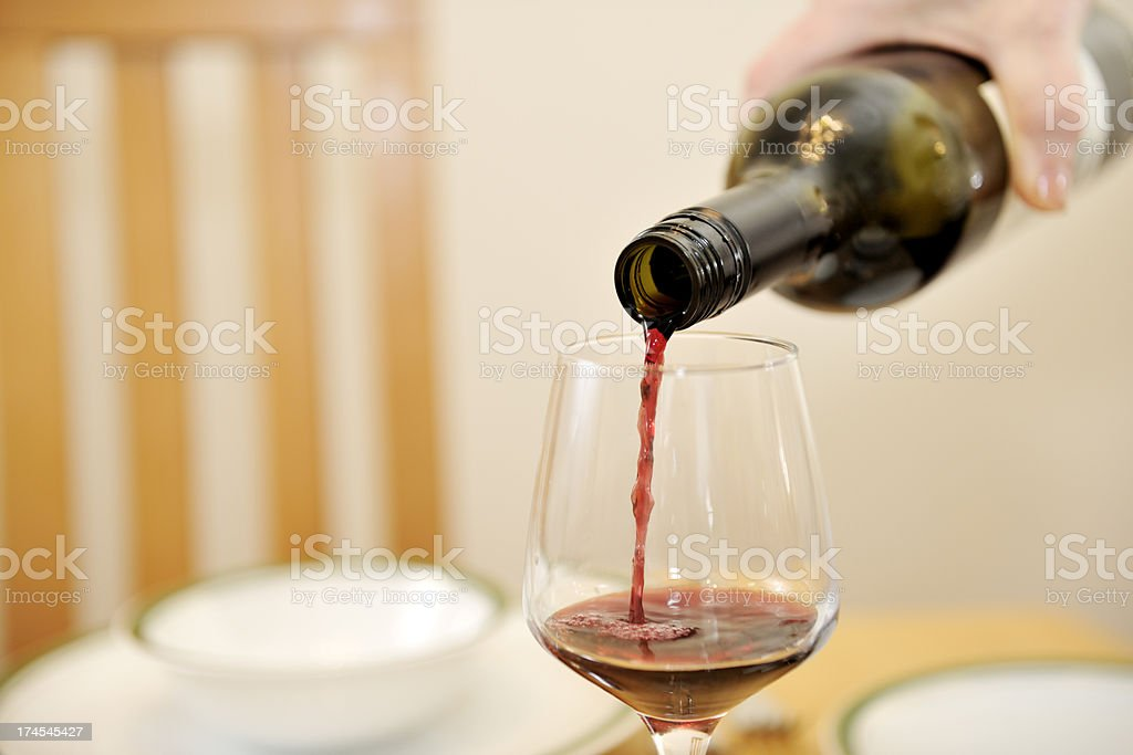 pouring wine in glass royalty-free stock photo