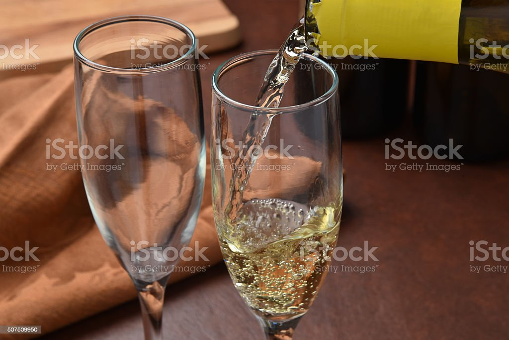 Pouring wine stock photo