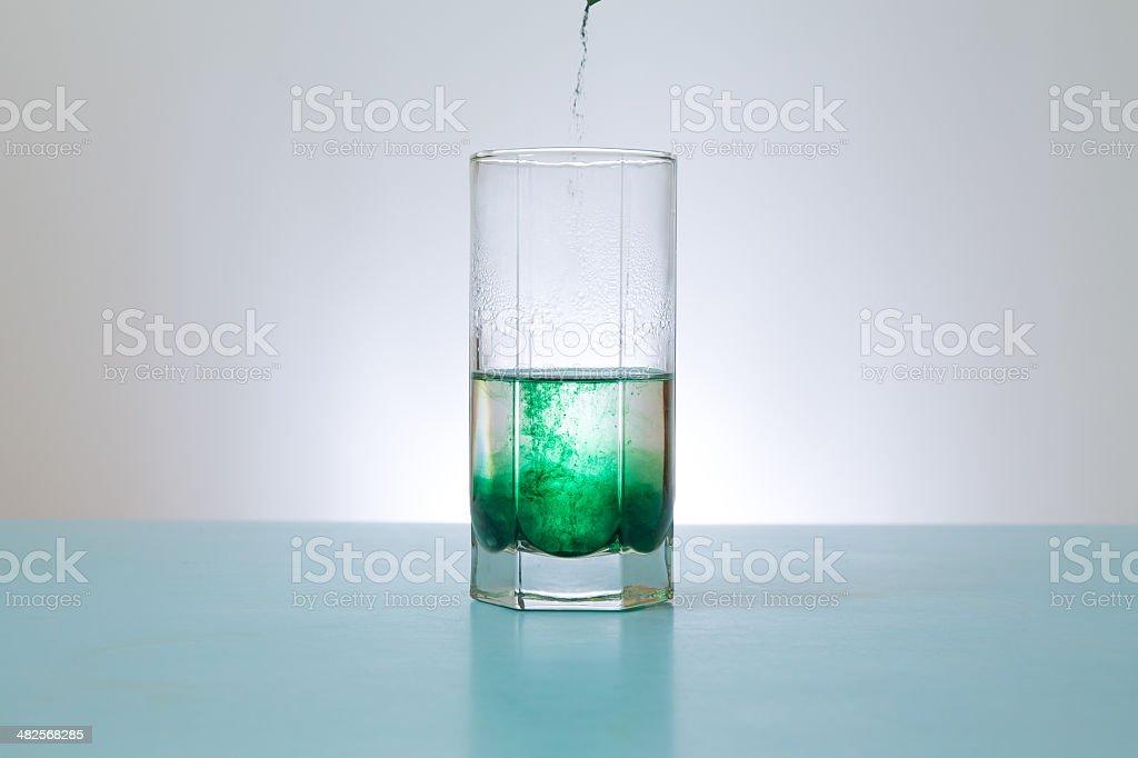 pours into glass green powder stock photo