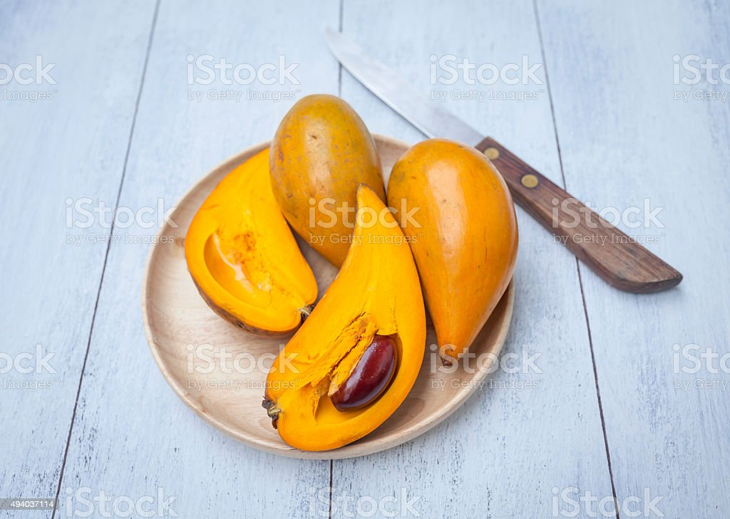 Pouteria Campechiana fruit in wooden plate stock photo