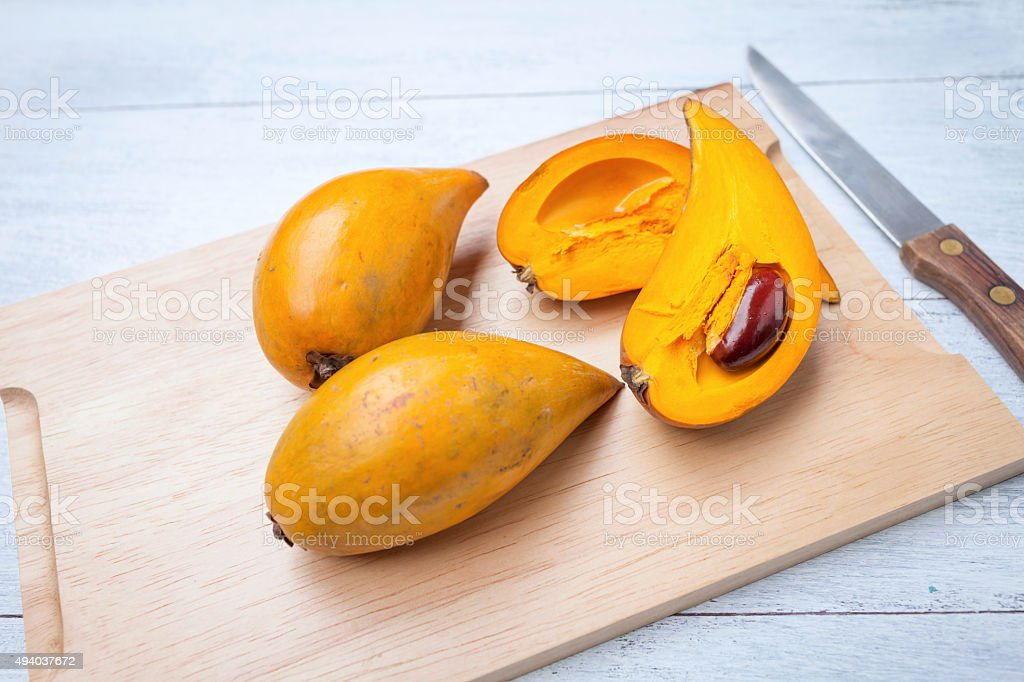 Pouteria campechiana on wooden cutting board stock photo