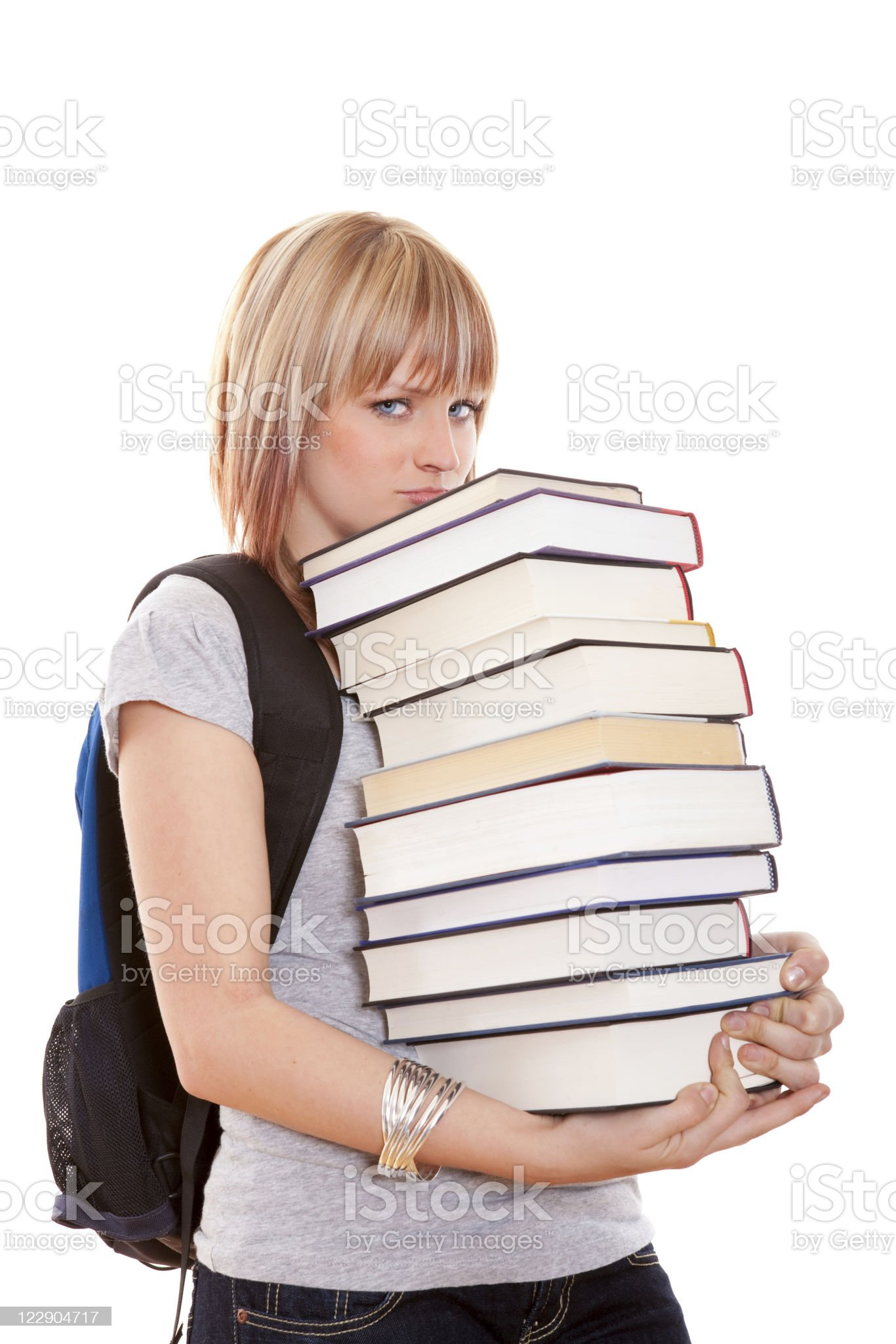 Pouting female holding a stack of books royalty-free stock photo