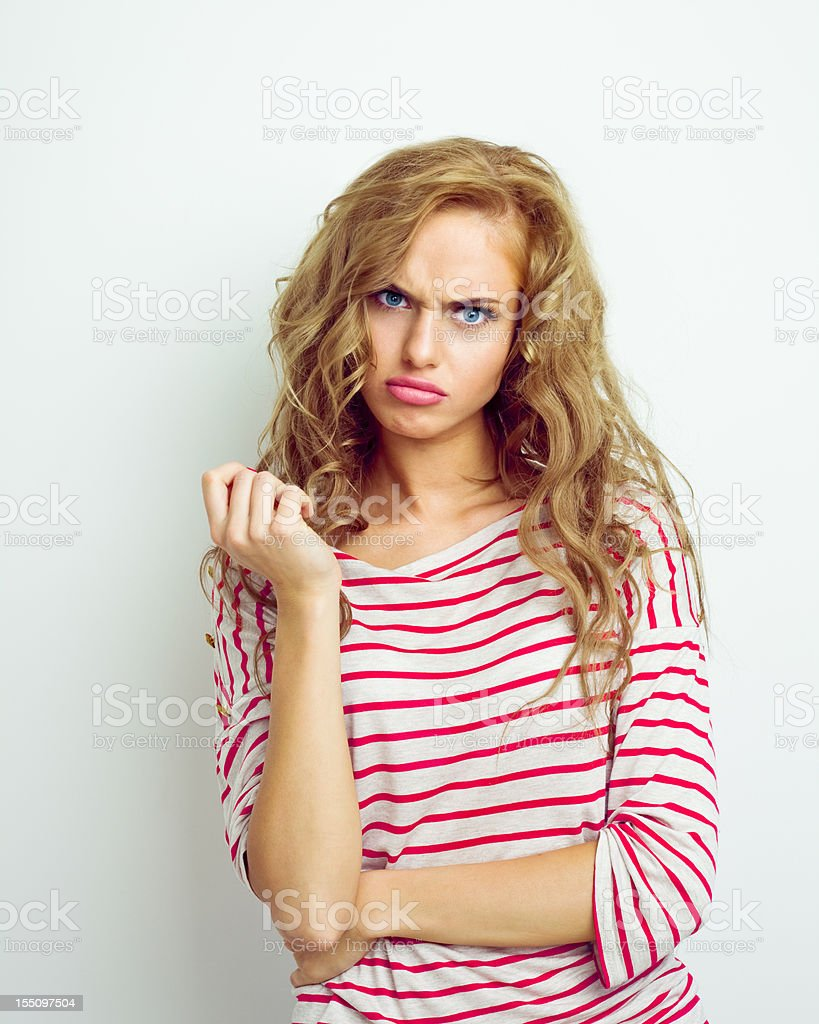 Pouting young woman stock photo