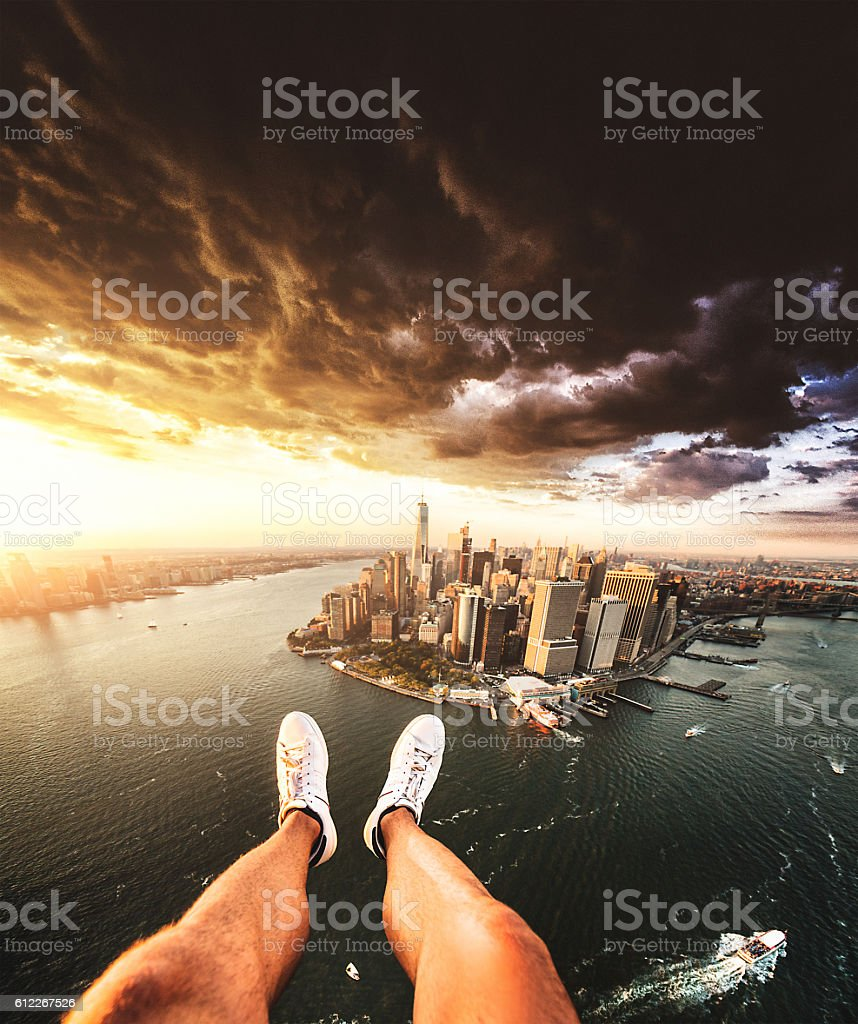 Pov of human leg with Manhattan skyline from helicopter stock photo
