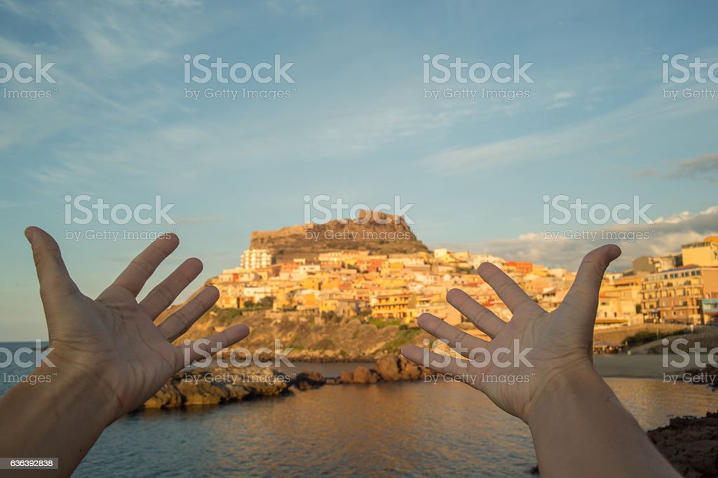 Pov of person arms outstretched towards Italian village and sea stock photo