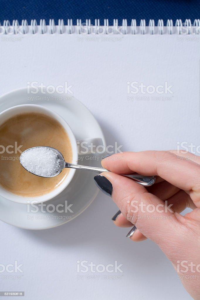 pov woman having sugar in coffee stock photo