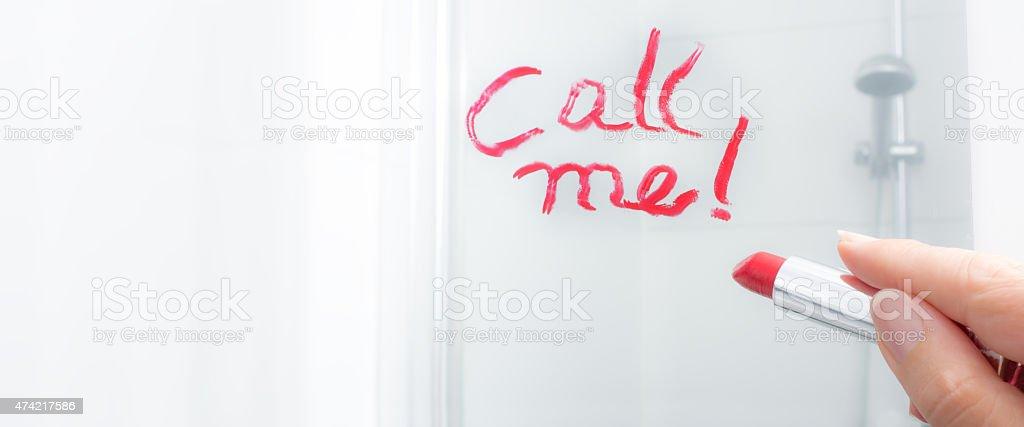 pov writing Call me  on a bathroom mirror stock photo