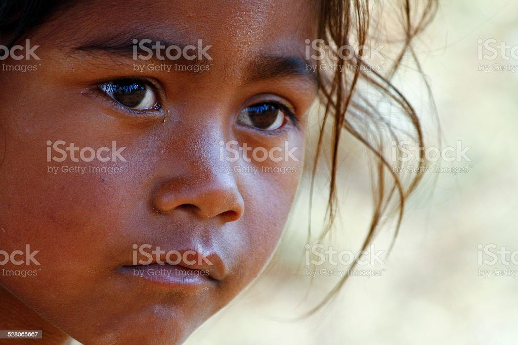 Poverty, portrait of a poor little African girl stock photo