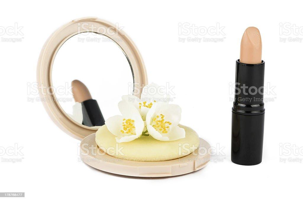 Powder and lipstick with jasmine flowers royalty-free stock photo