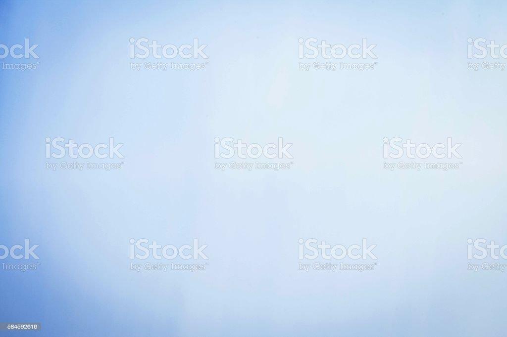 Powder blue background with vignette.