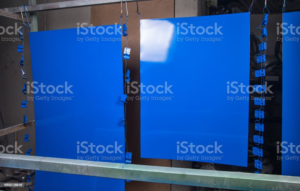 Powder coating and drying of blue details stock photo