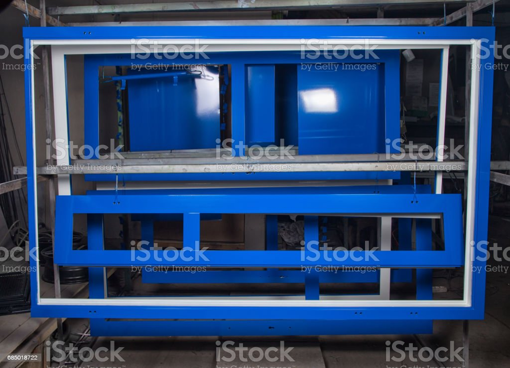 Powder coating and drying of metal doors stock photo