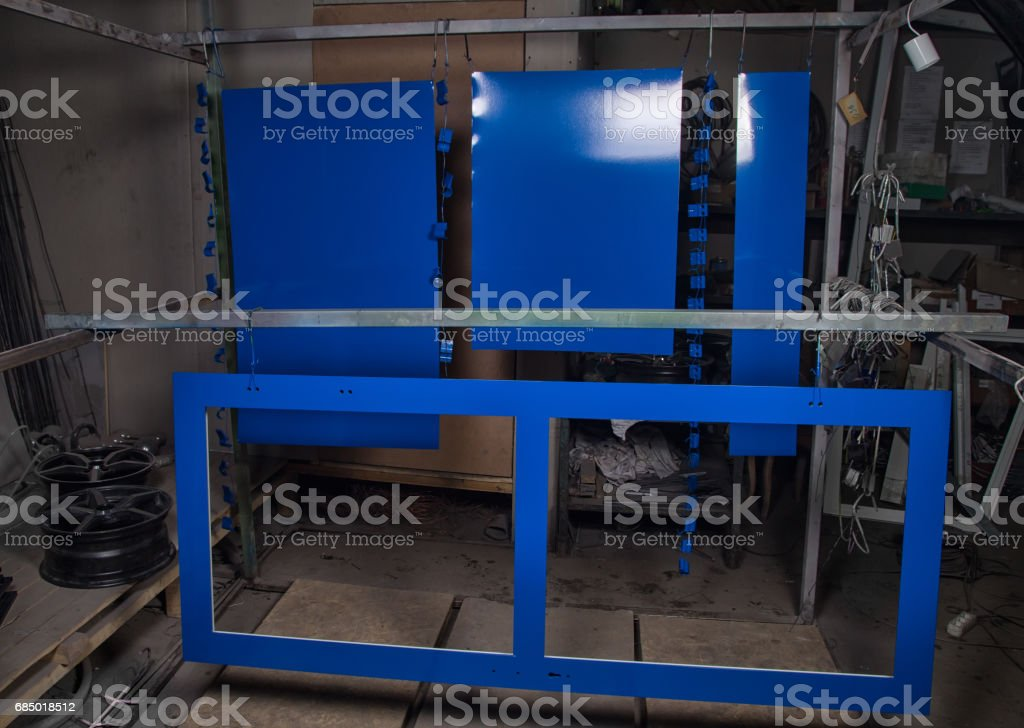 Powder coating and drying of metal items stock photo