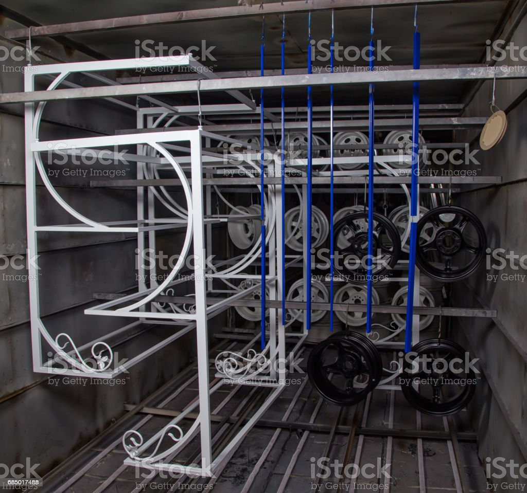 Powder coating of different metal details stock photo