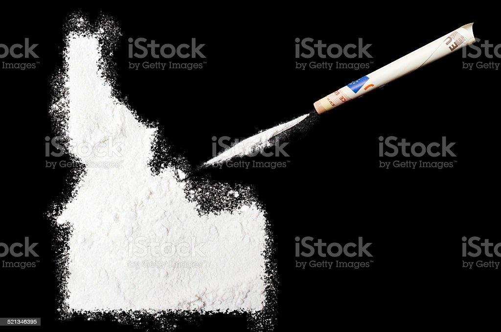 Powder drug like cocaine in the shape of Idaho stock photo