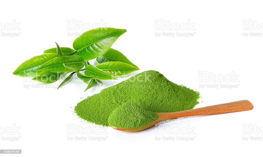 powder green tea and green tea leaf stock photo