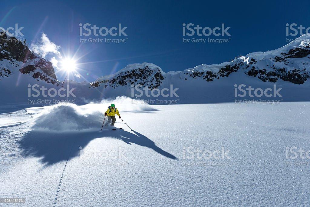powder heli skiing stock photo