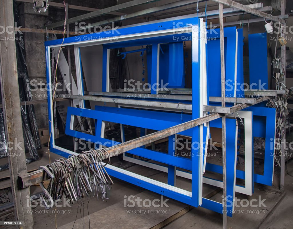Powder painting and drying of metal blue doors stock photo