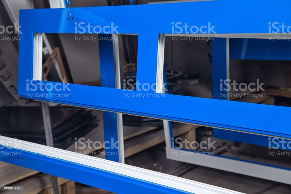 Powder painting of metal blue doors stock photo