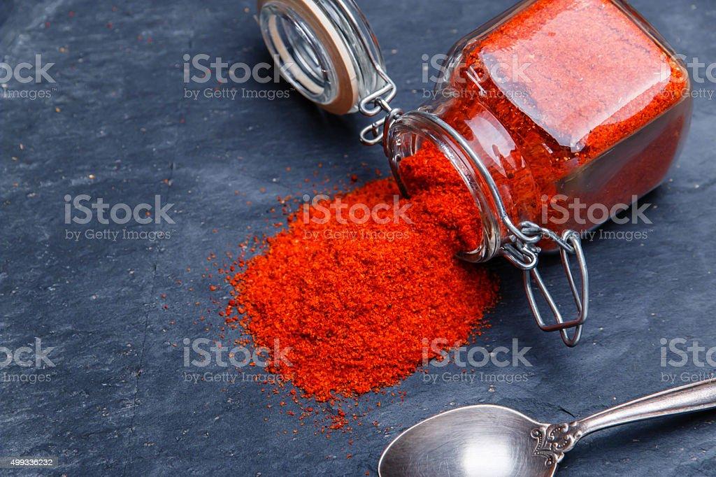 powder seasoning spice paprika on a black stone stock photo