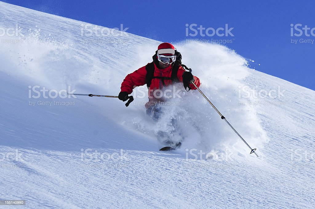 Powder skiing beautiful fluffy untracked lines stock photo