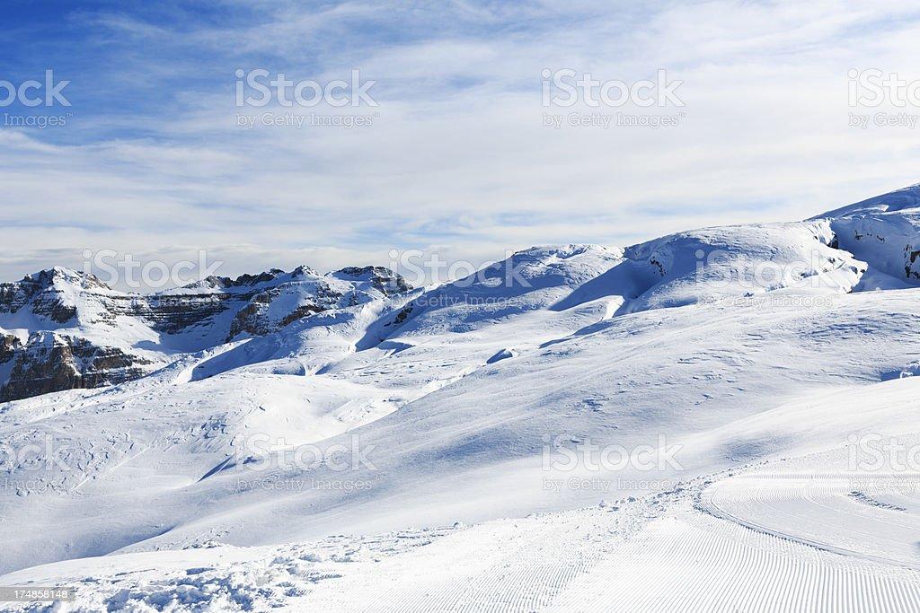 Powder snow at mountain peaks royalty-free stock photo