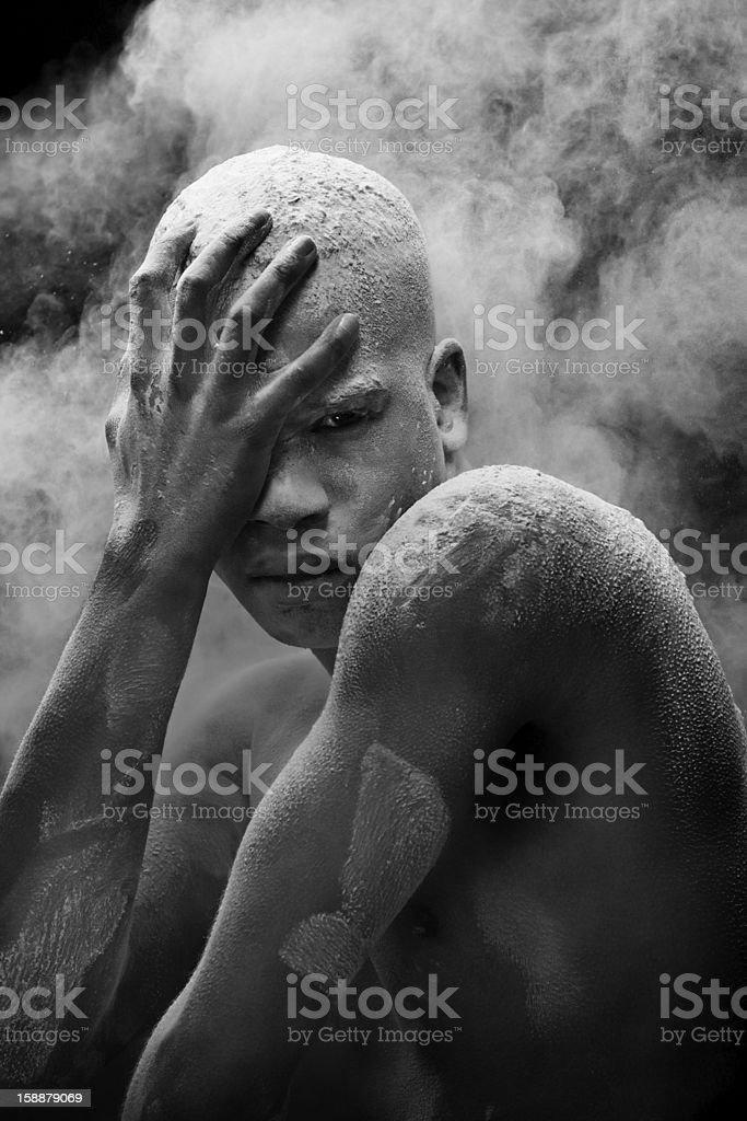 powder splashing on black male model royalty-free stock photo