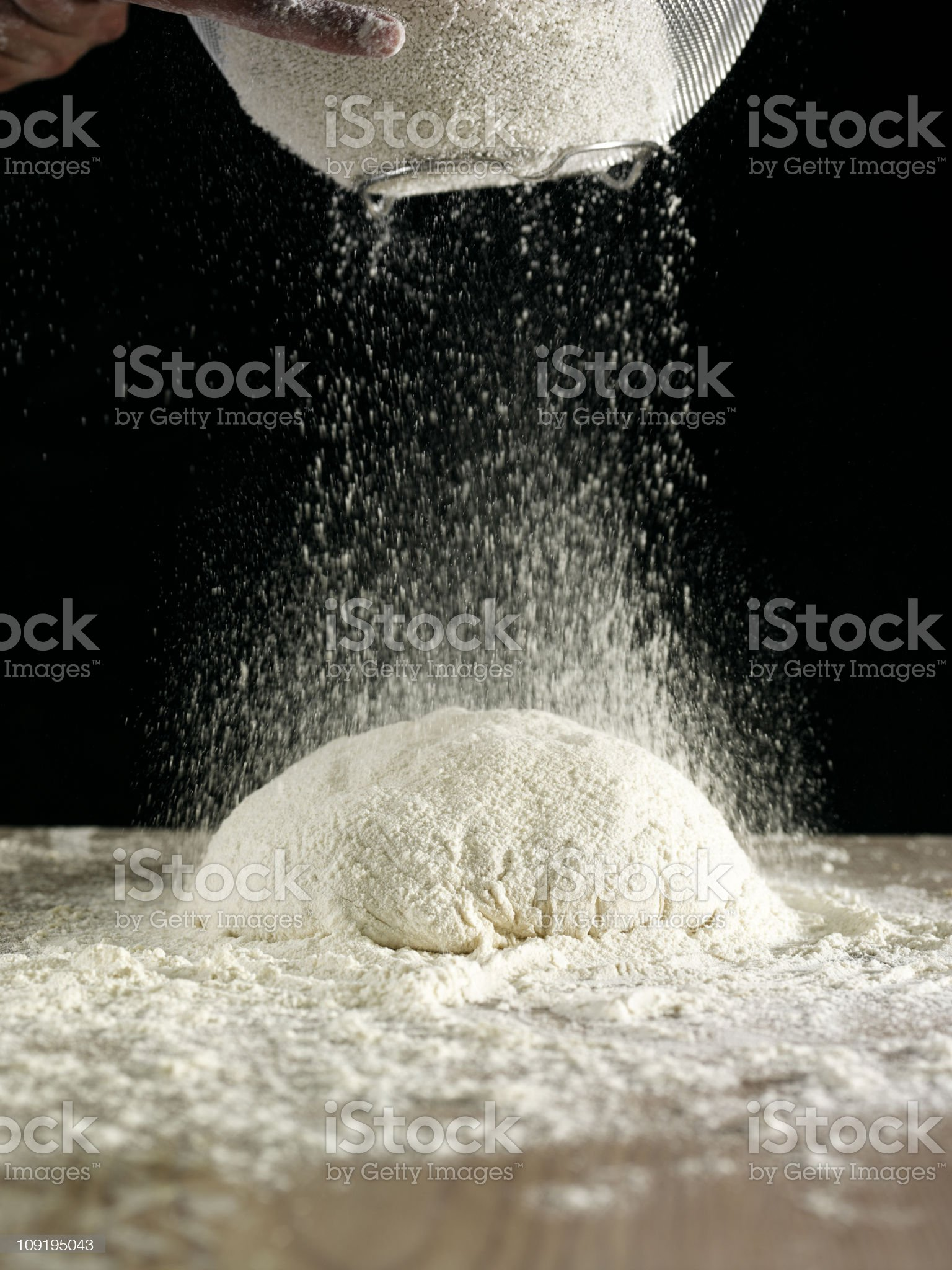 Powdered dough being sprinkled in the preparation of batter royalty-free stock photo
