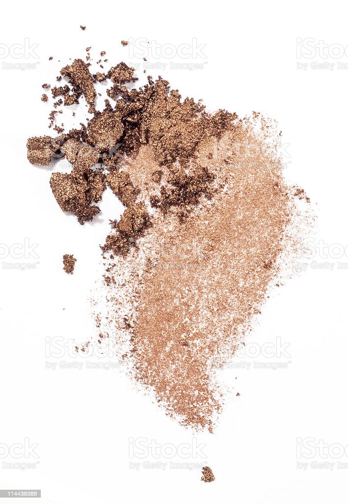 Powdered eyeshadow in a nude color over white background stock photo
