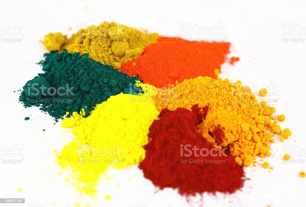 Powdered pigments of orange, red, yellow, green stock photo