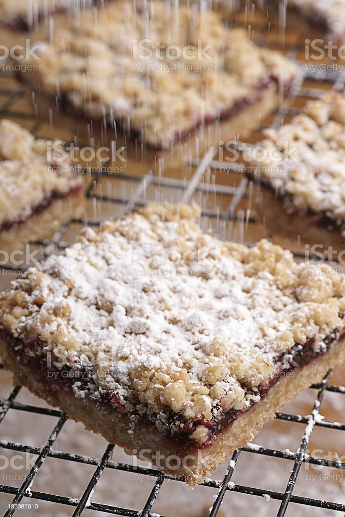 Powdered Sugar Falling on Raspberry Bars stock photo