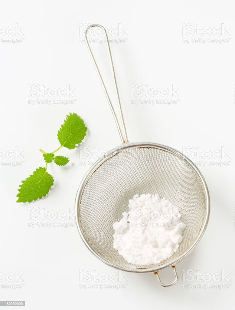 Powdered sugar in a sieve stock photo