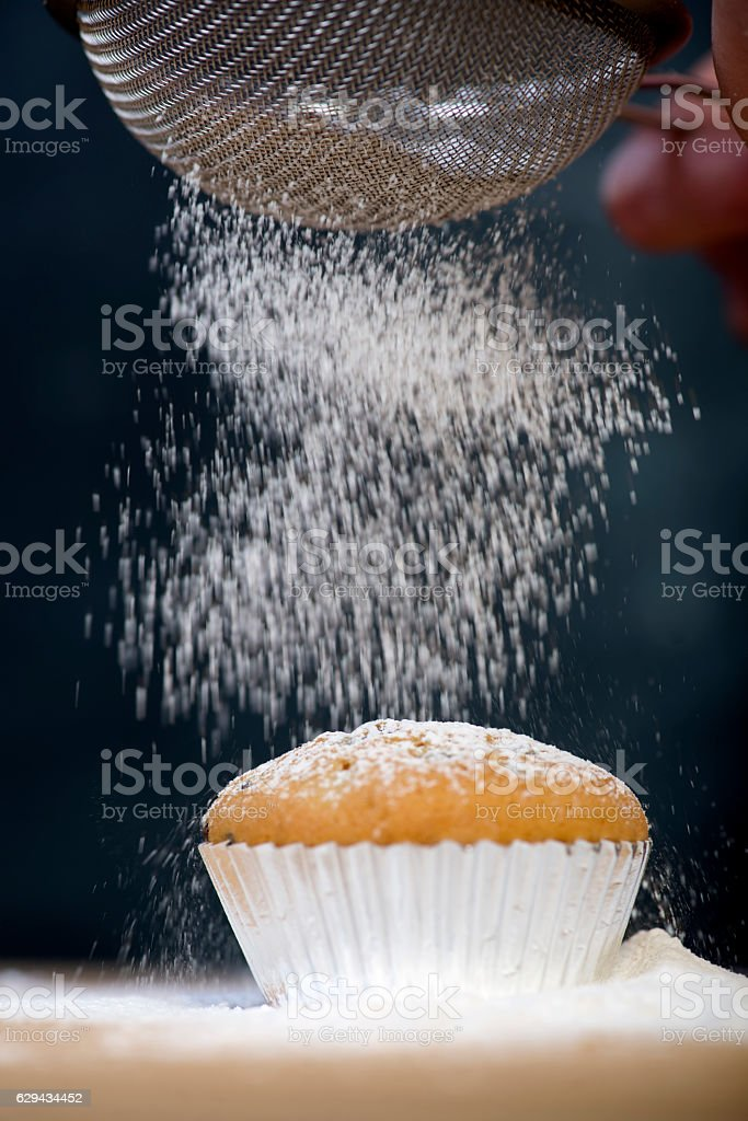 Powdered sugar sprinkled on top of the cake stock photo