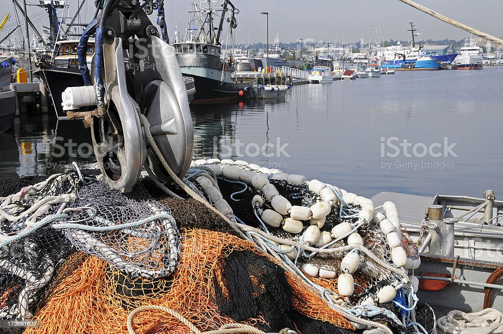 Power block and fishing nets on boat royalty-free stock photo