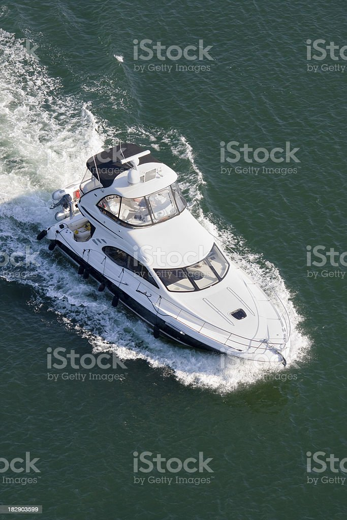 Power boat cruising into the marina. royalty-free stock photo