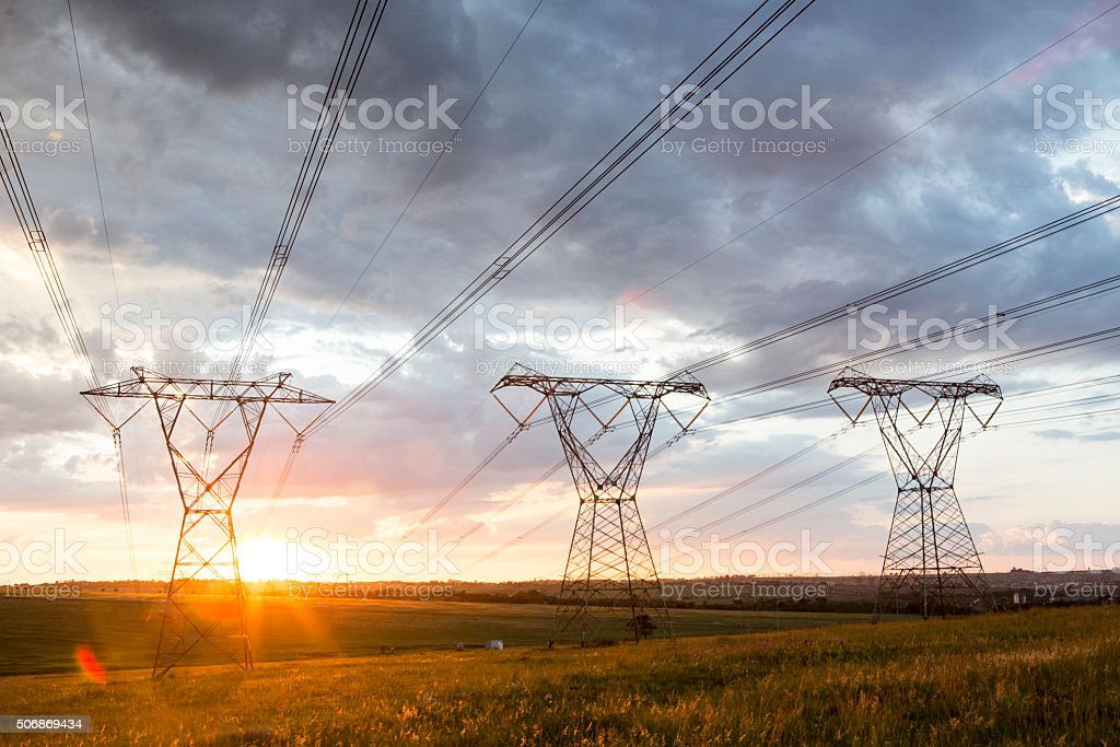 Power cable with beautiful background with sunset three landscape stock photo