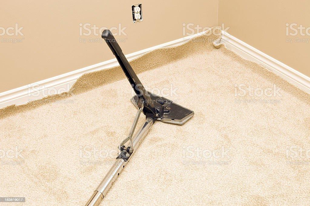 Power Carpet Stretcher on New Bedroom Floor stock photo