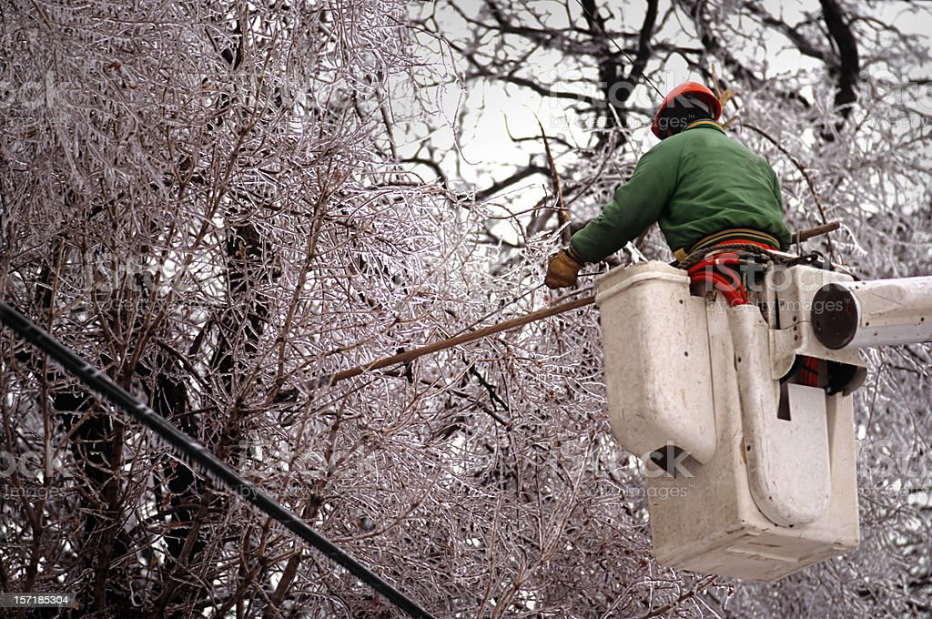 Power company doing repairs after a winter storm royalty-free stock photo