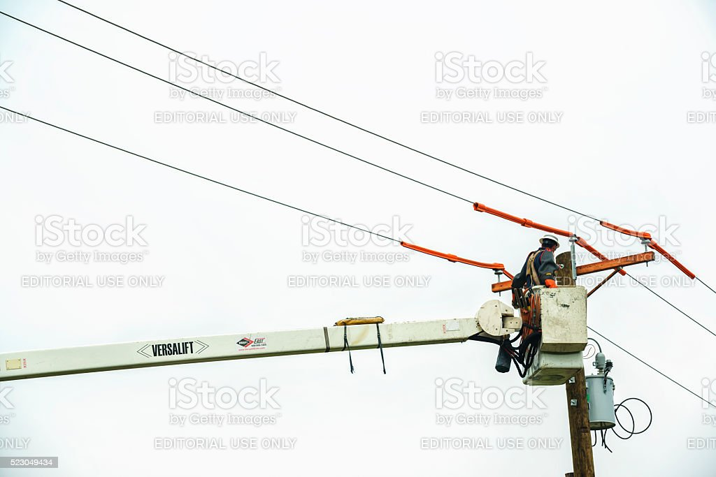 Power crews replace old telephone pole stock photo