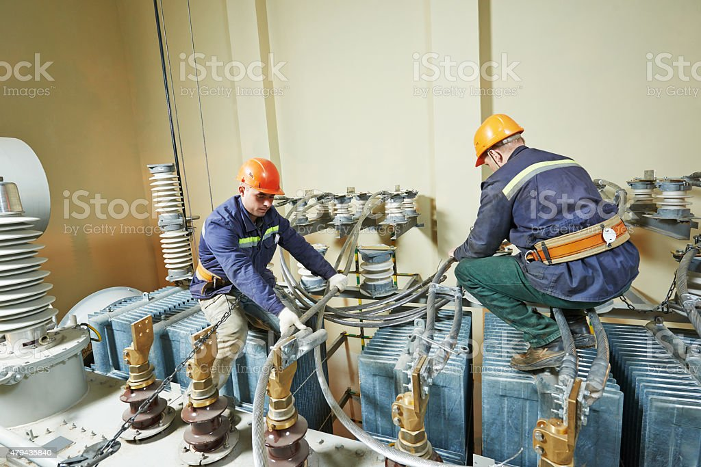 power electricians lineman at work stock photo