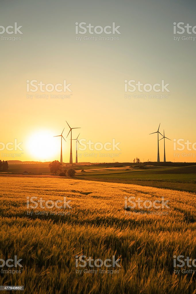 power generating wind turbines stock photo