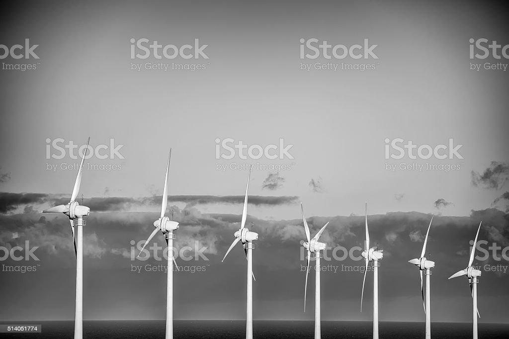 power generating wind turbines stock photo