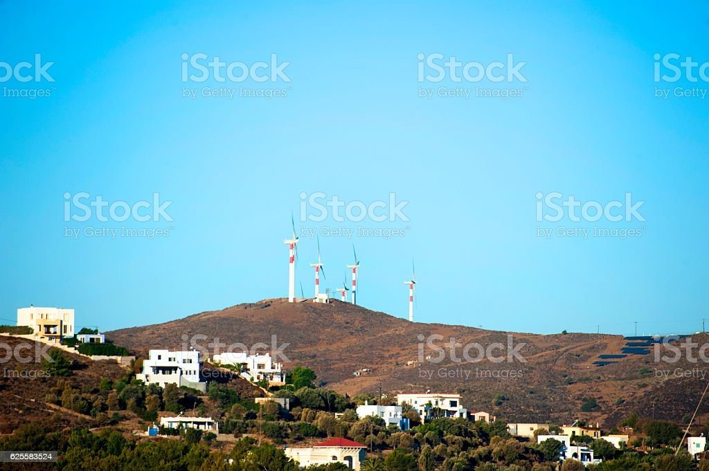 Power Generating Windmills and houses stock photo
