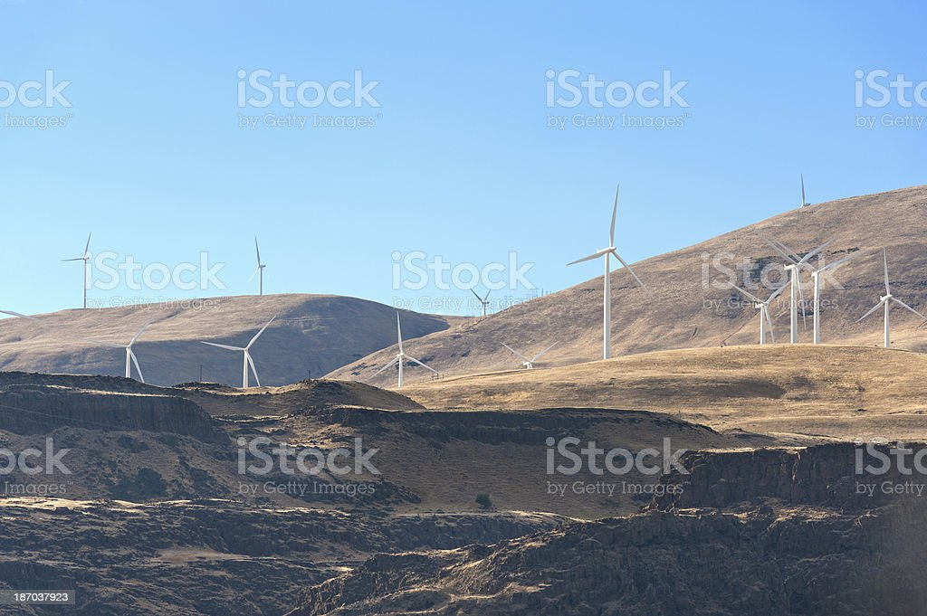 Power Generating Windmills on top of cliffs stock photo