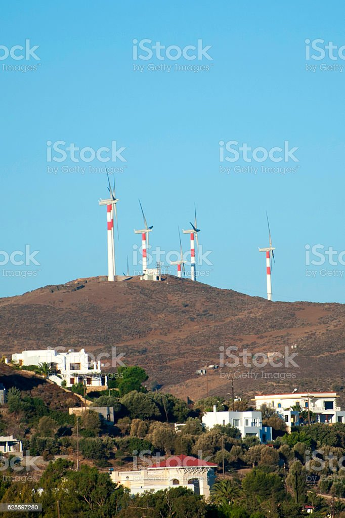 Power Generating Windmills with houses stock photo