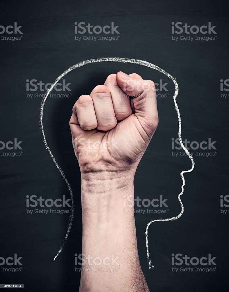 power head on blackboard stock photo