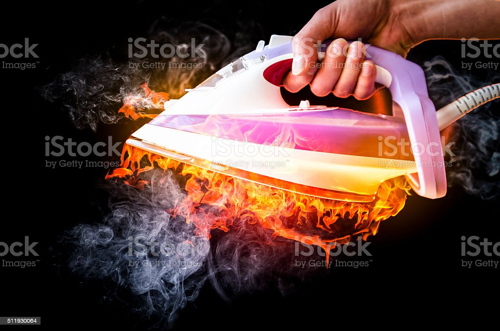 power ironing fire and smoke stock photo