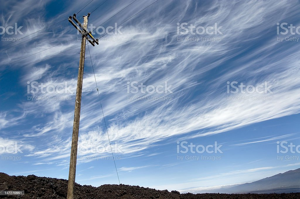 Power line against vibrant sky on the volcano. royalty-free stock photo